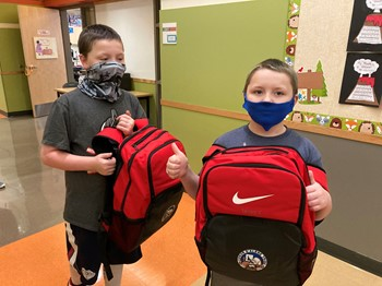 Sargent brothers with their new backpacks