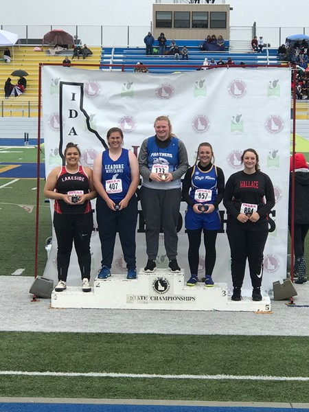Kamryn Hendrickx medals at state track with a 4th place finish in the shot put.